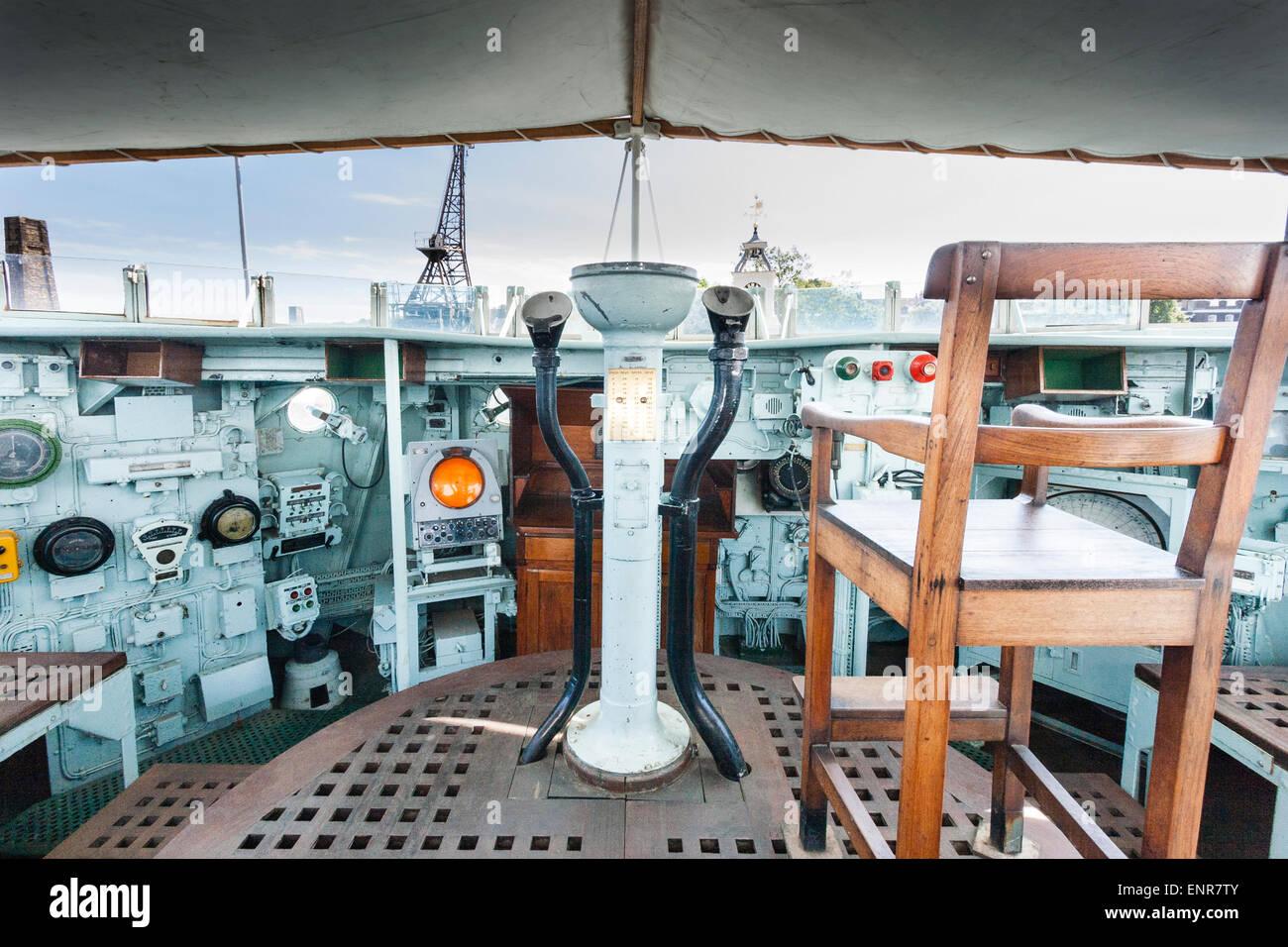 England, Chatham Dockyard. English warship, C class destroyer R73 HMS Cavalier, bridge and Captain's chair - Stock Image