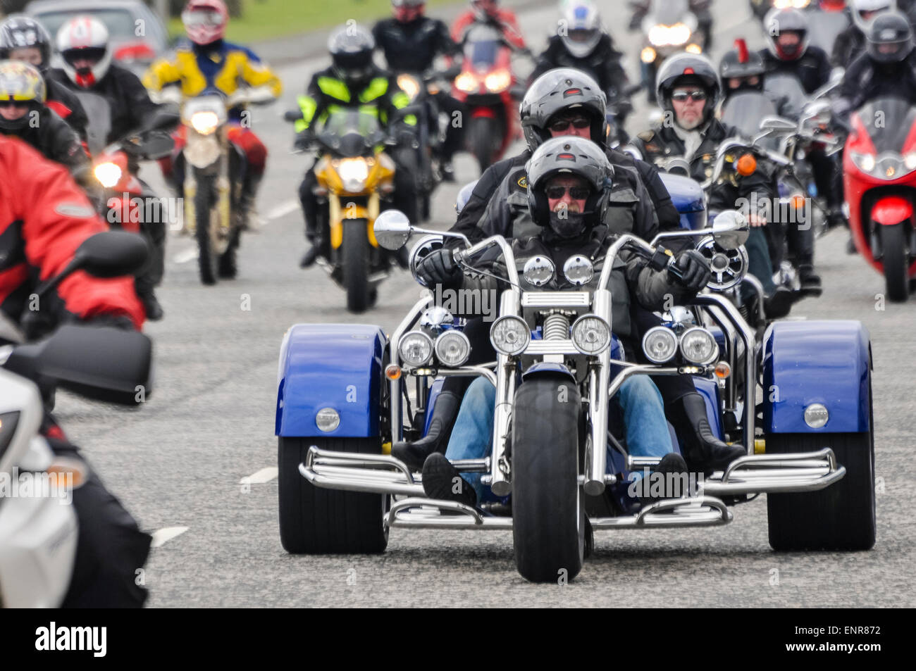 Carrickfergus, Northern Ireland. 10 May 2015. A man and passenger ride on a three wheeled motorcycle as Quay Vipers - Stock Image