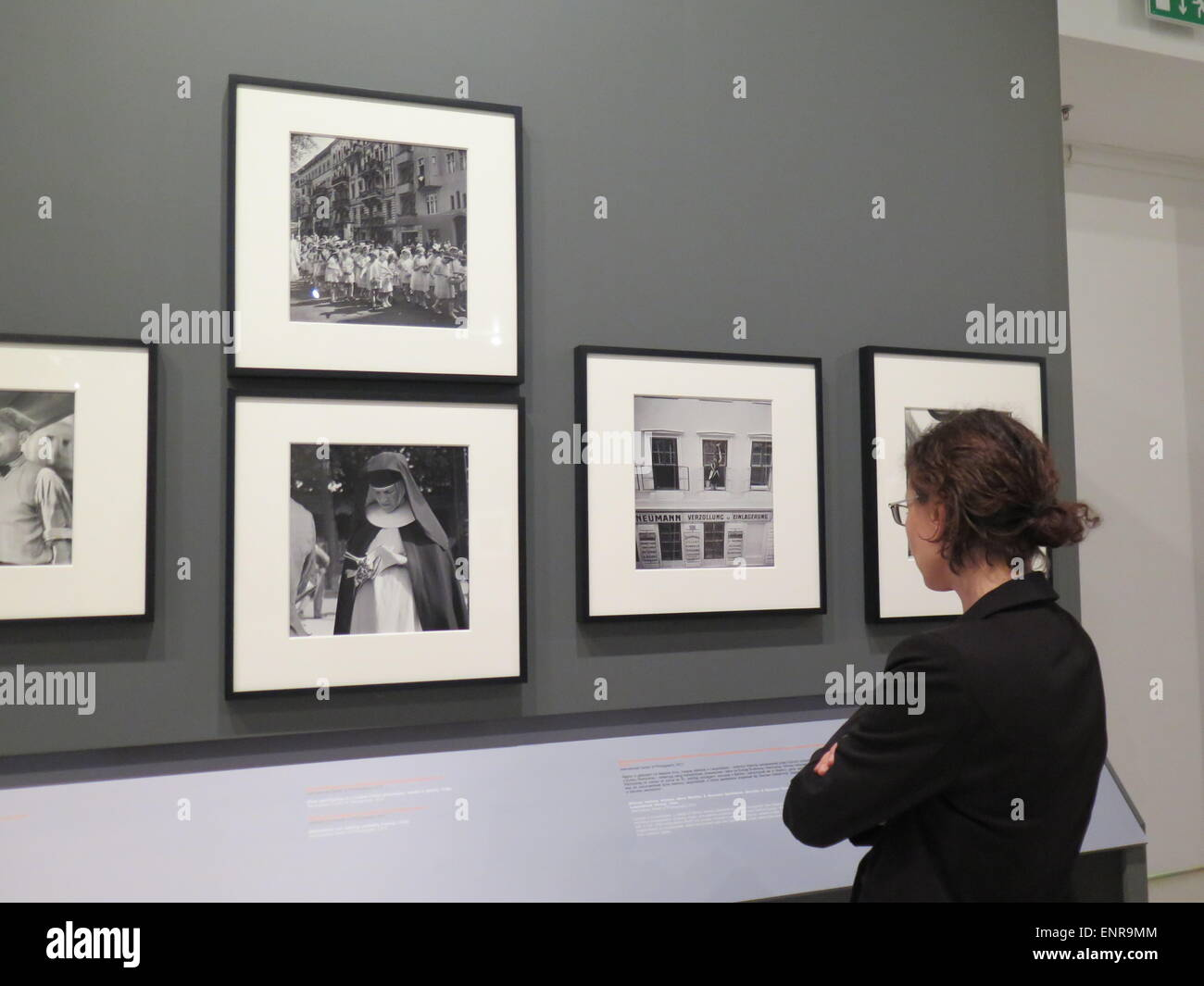 A visitor looks at the exhibition of photographs by Roman Vishniac in Warsaw, Poland. The exhibition on the Roman - Stock Image