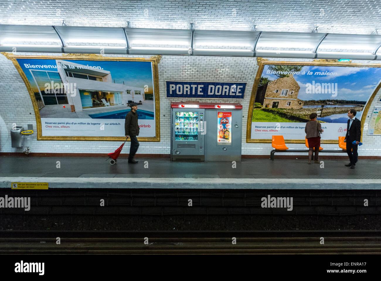 Paris, France, People on Platform inside Metro Underground Subway Station, Porte Doree with French Advertising Poster Stock Photo