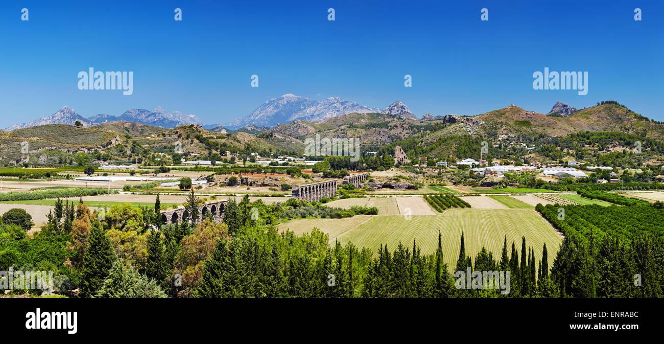 Ruins of ancient Roman aqueduct in Aspendos near Antalya, Turkey - Stock Image
