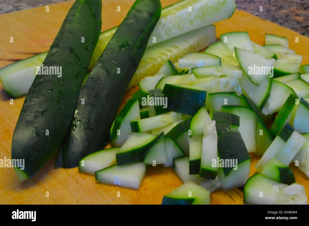 Freshly sliced and cut juicy cool cucumbers - Stock Image