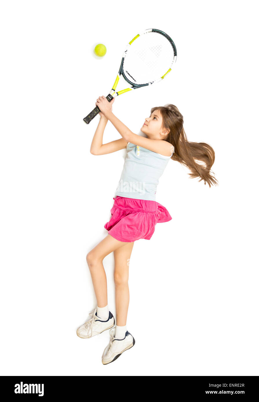 Isolated photo of happy brunette girl playing tennis - Stock Image
