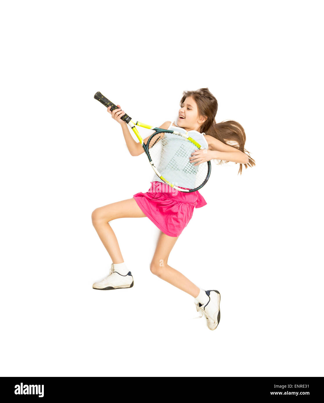 Isolated photo of happy smiling girl playing on tennis racket as on guitar - Stock Image
