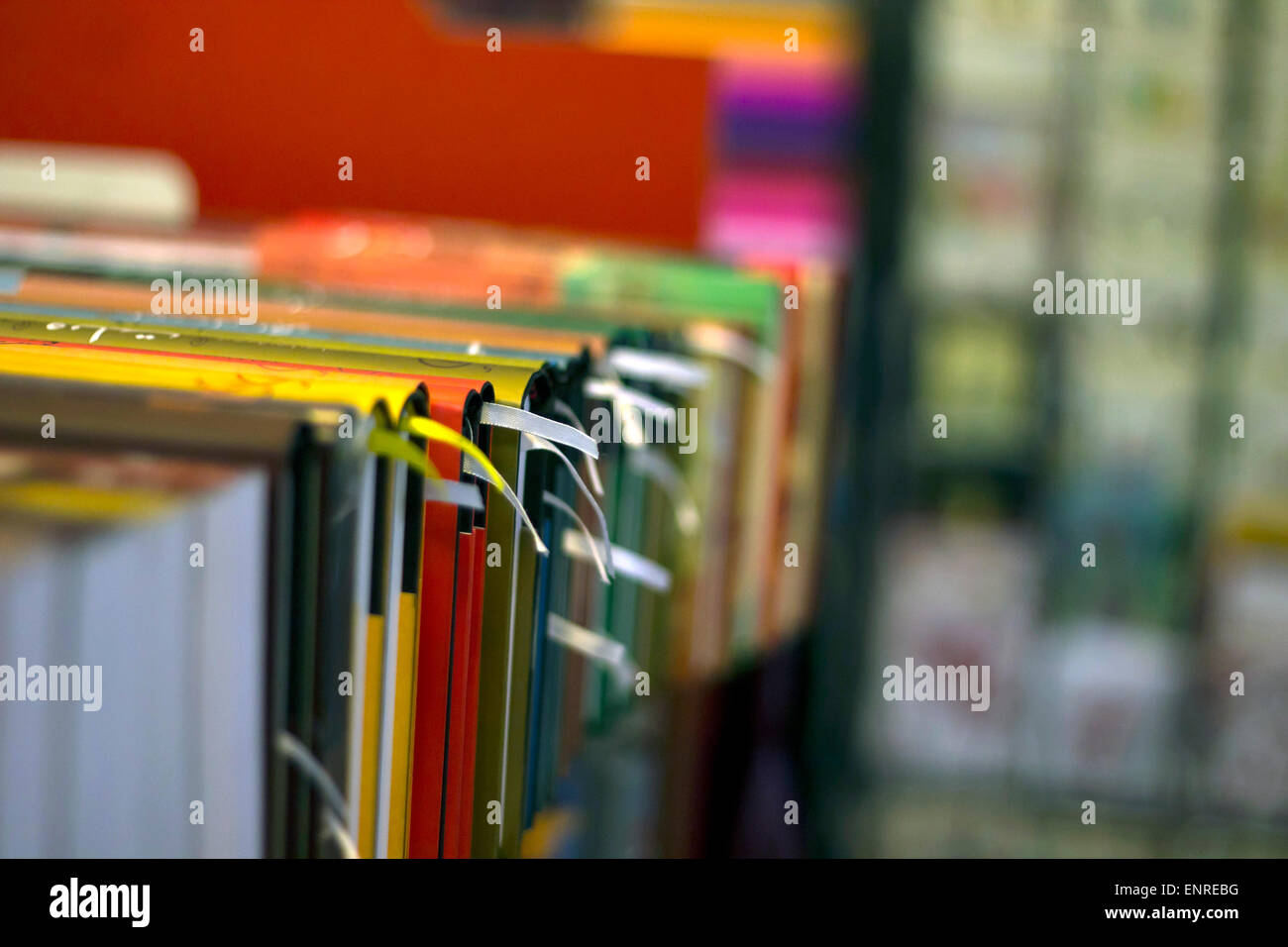 Bookshelf and book row in a book shop and library - Stock Image