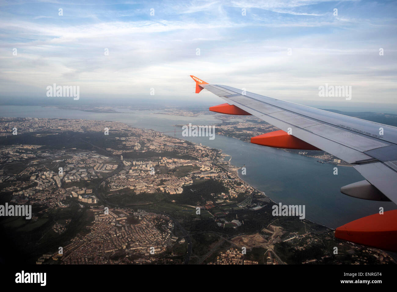View from airplane window over Lisbon Portugal on a EasyJet flight. - Stock Image