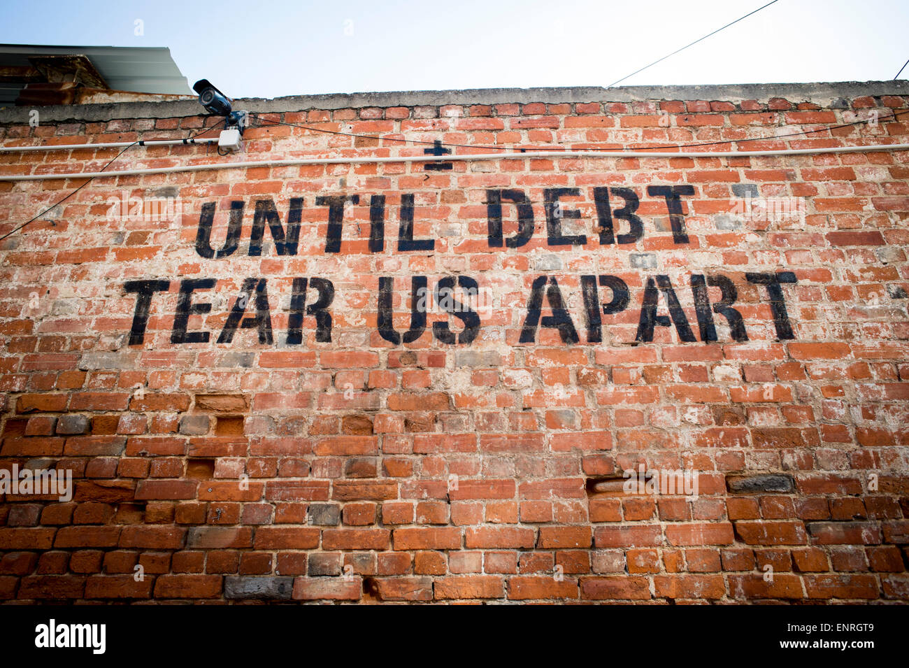Until debt tear us apart message on a wall in the LX factory area of Lisbon, Portugal. - Stock Image