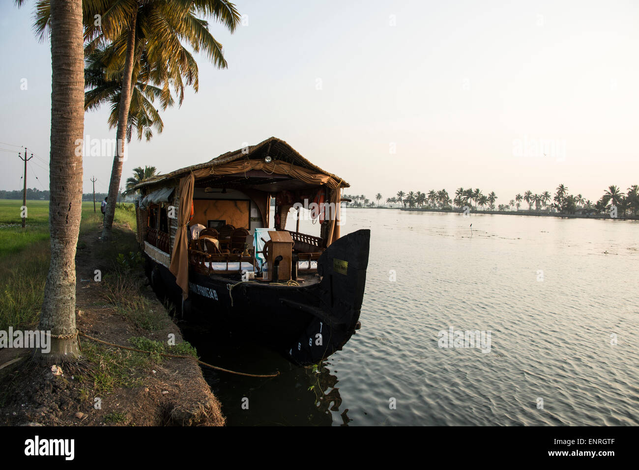 A  moored  House boat known locally as 'kettuvallam' along the picturesque and peaceful backwaters of Kerala - Stock Image