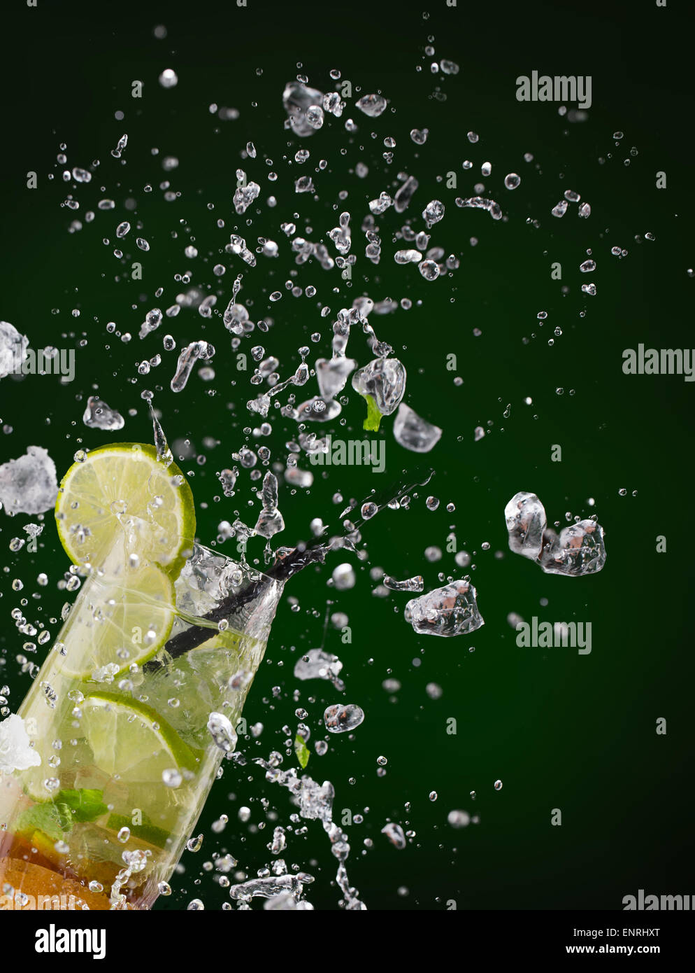 Fresh mojito drink with ice cubes and splashes on black background Stock Photo
