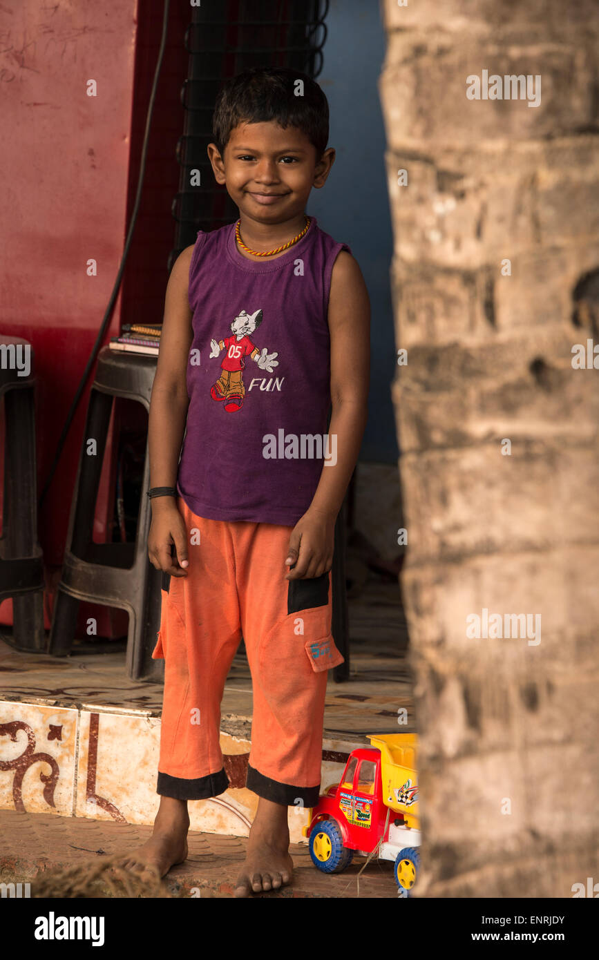 A young Indian boy at his home on the backwaters of Kerala in India - Stock Image
