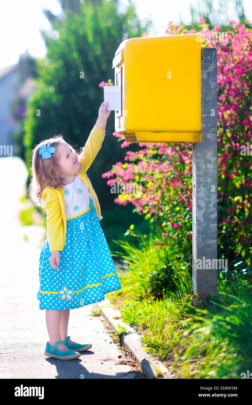 Little Girl With An Envelope At Post Office Child Sending Letter