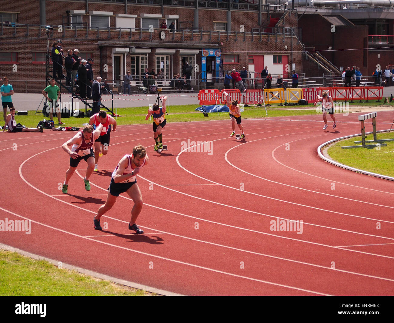 Runners set off on an 800M race at the Mountbatten Centre, Portsmouth, Hampshire, England - Stock Image