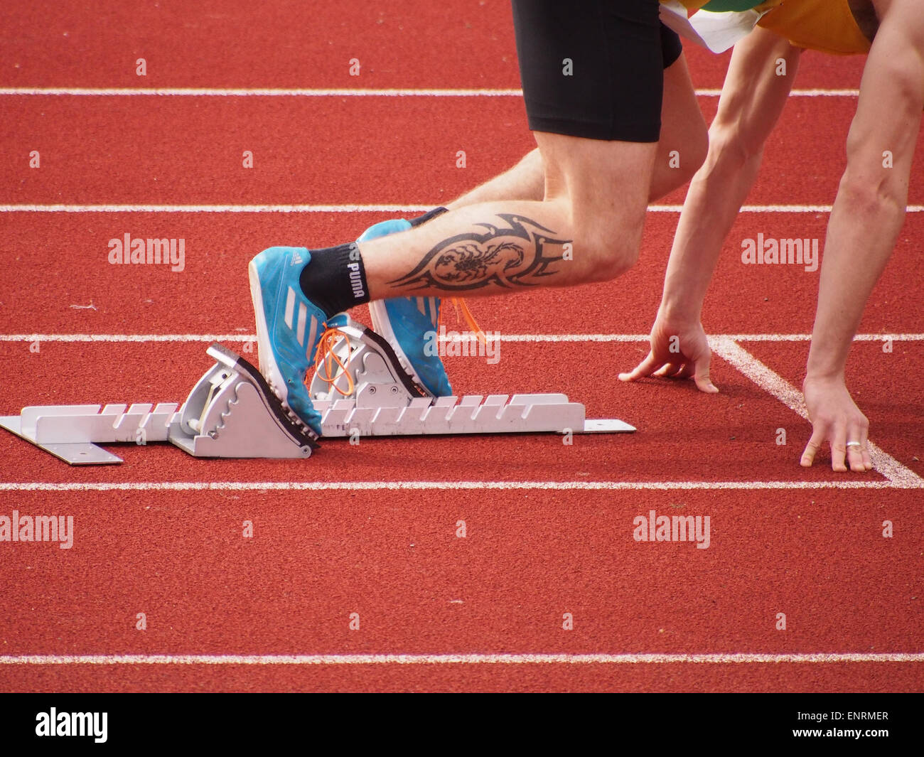 more photos 0bcdc cf8ff An Athletes feet placed firlmy onto starting blocks, ready ...