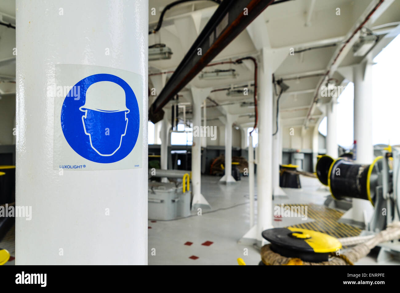 Bow of a cargo ship and safety sign for hard hat - Stock Image