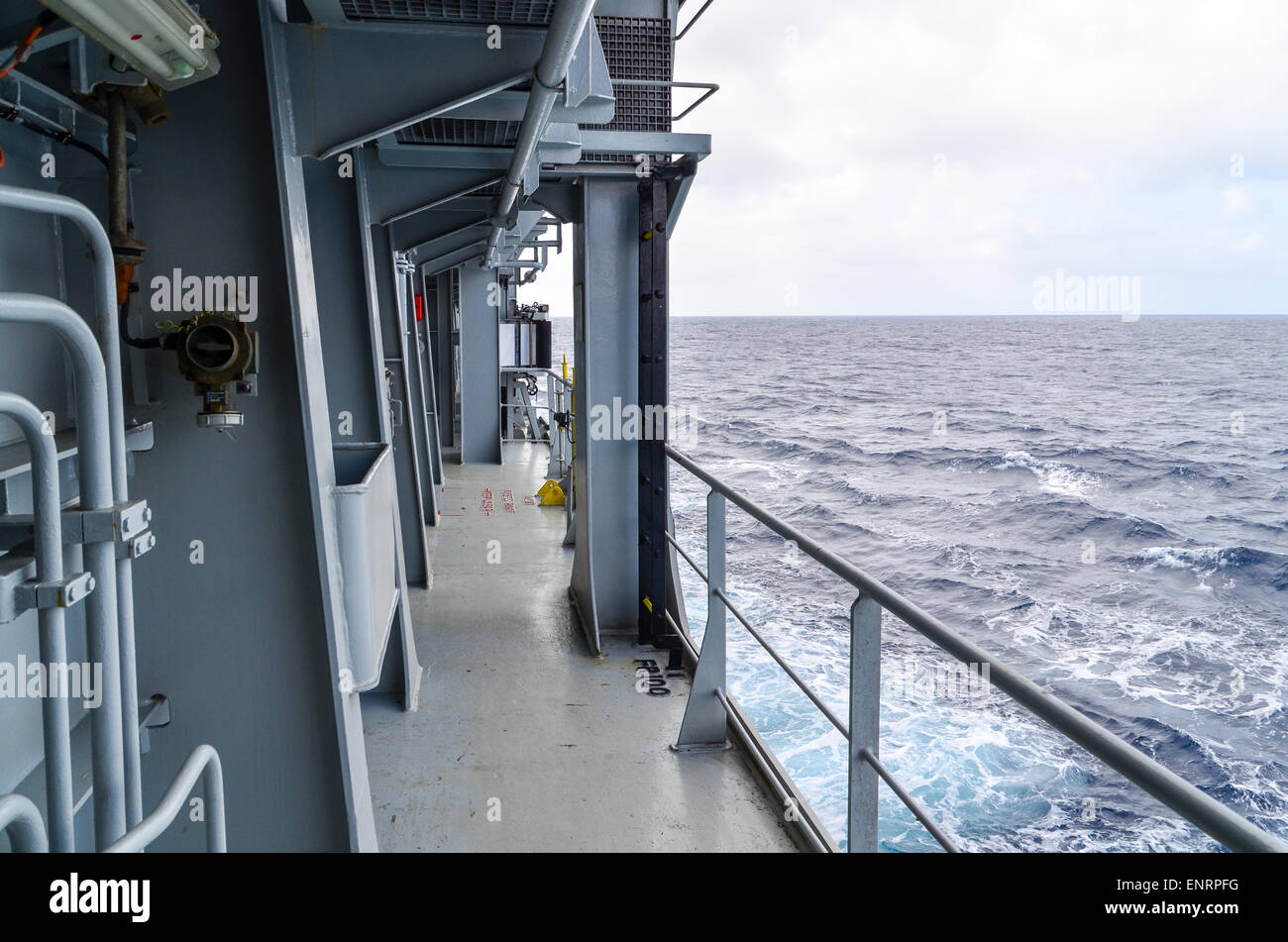 Cargo ship crusing in the ocean - Stock Image