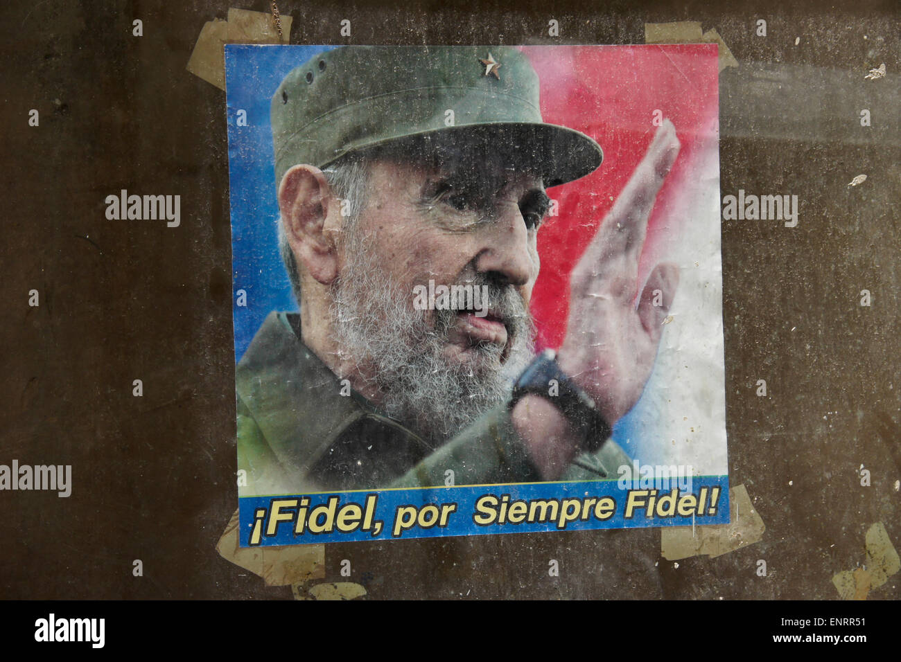Poster of Fidel Castro in window of abandoned building, Havana, Cuba - Stock Image