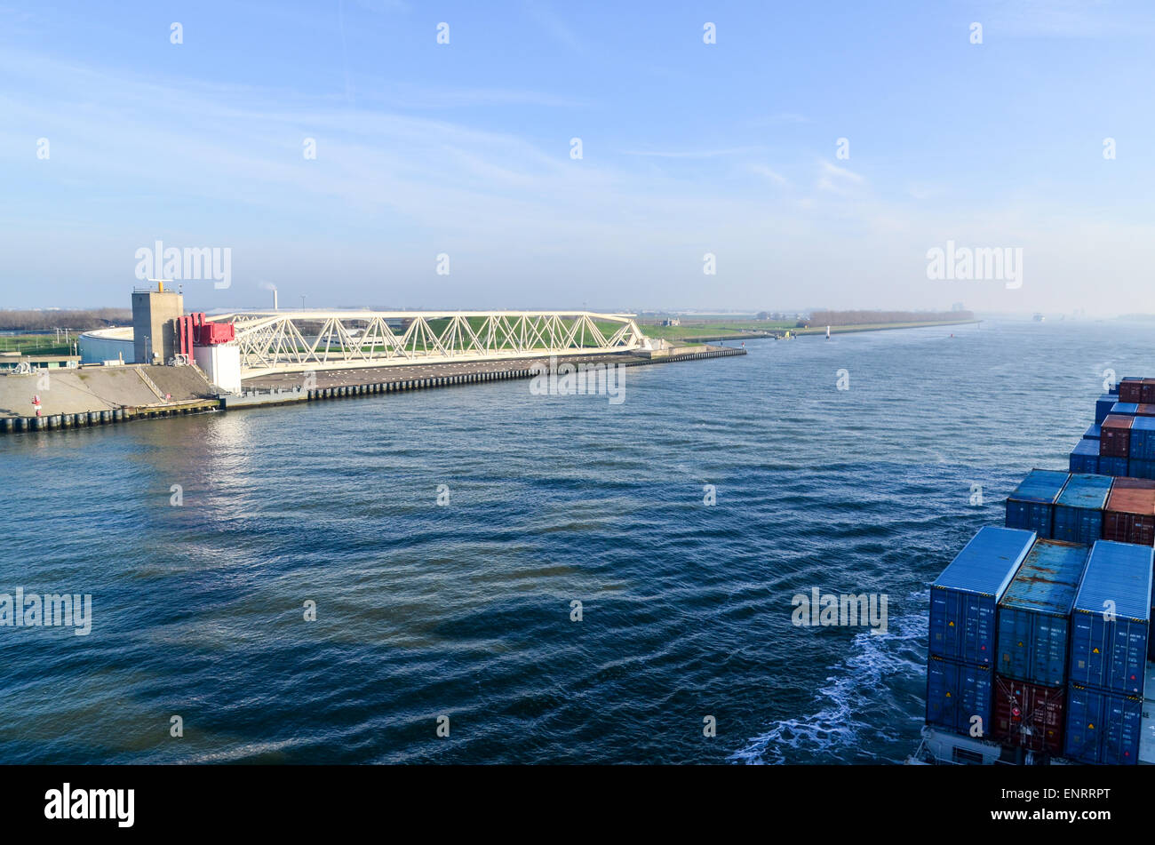 A cargo ship passing the Maeslantkering on the Nieuwe Waterweg, Rotterdam, a storm surge barrier - Stock Image