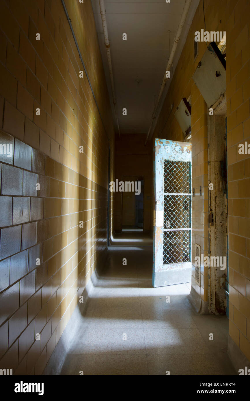 Lights from cells in hallway of institution. - Stock Image