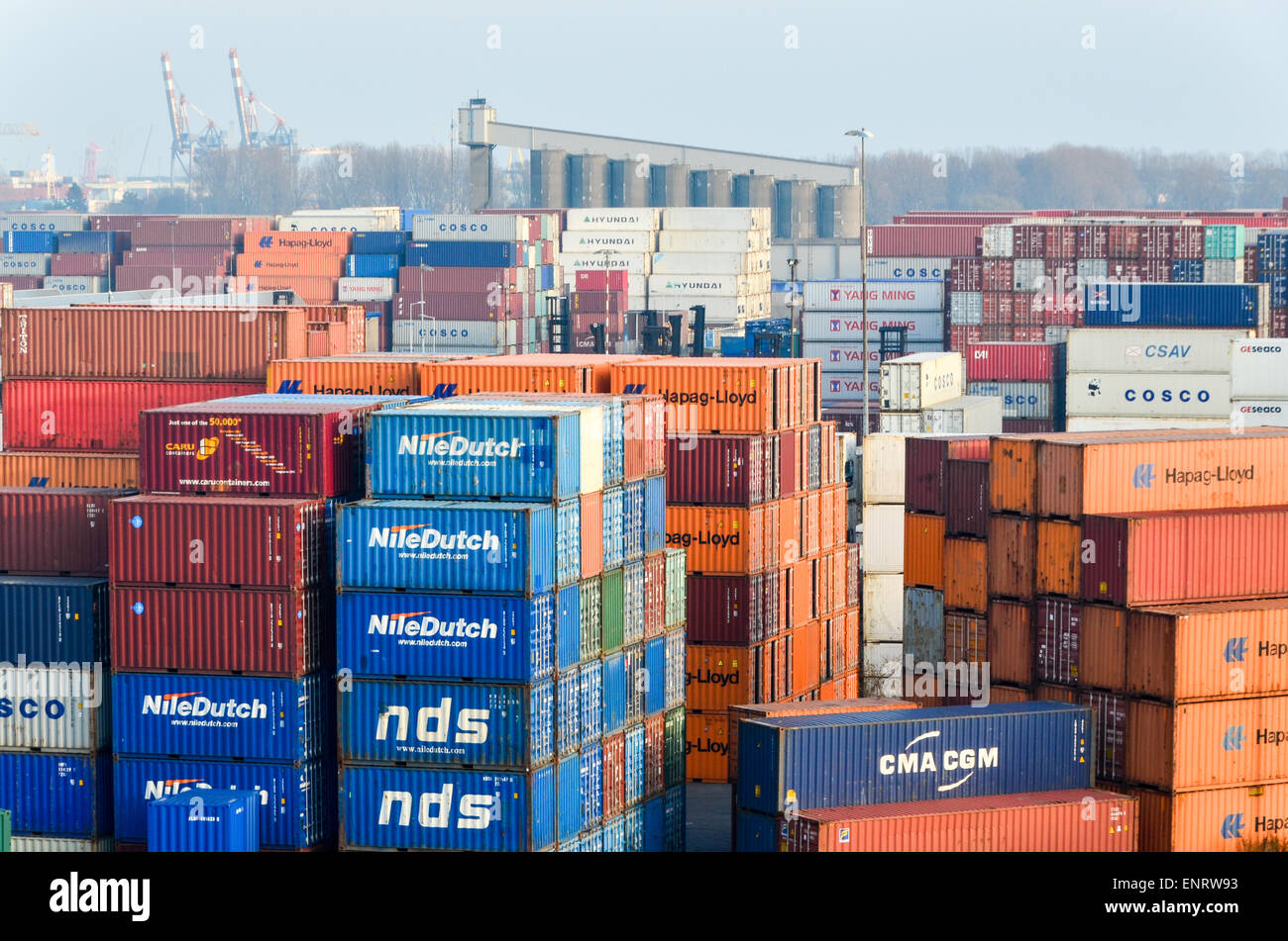 Piles of containers in the port of Rotterdam, Netherlands - Stock Image