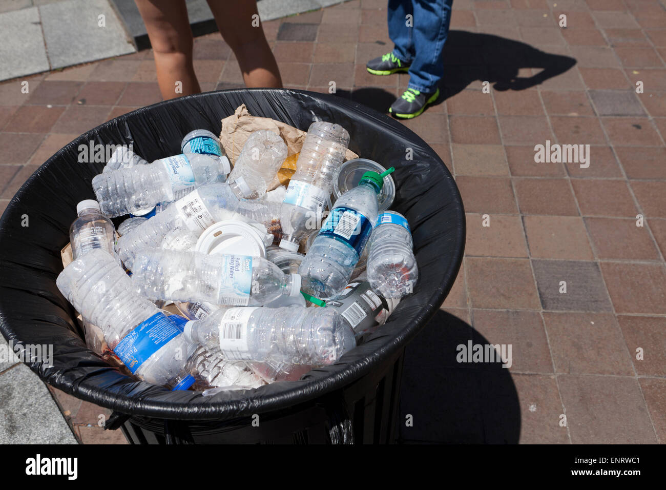 Plastic water bottles in public waste bin - USA - Stock Image