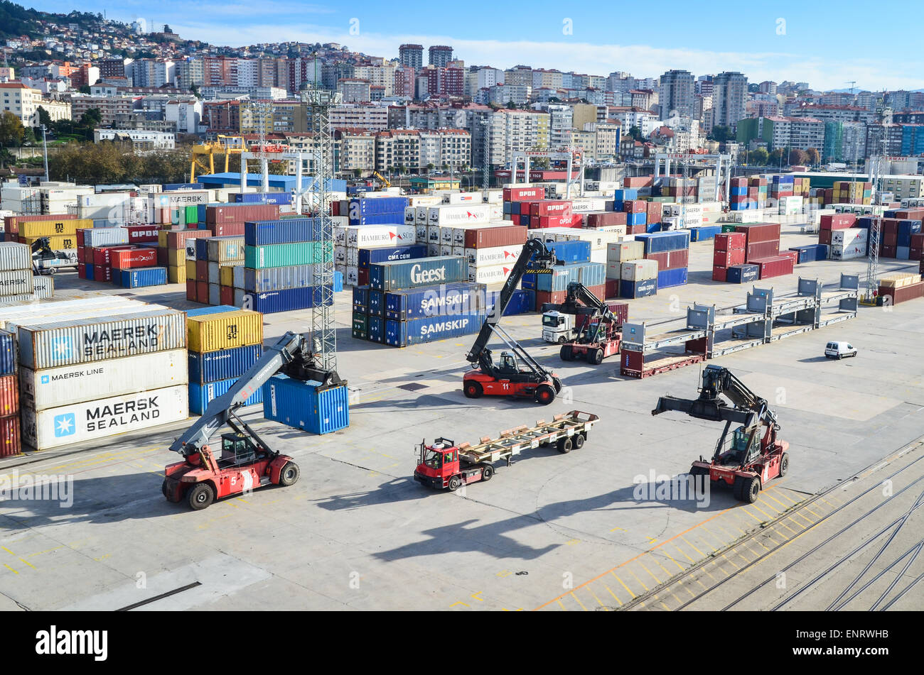 Cargo handling forklifts at the container terminal of the port of Vigo, Spain - Stock Image