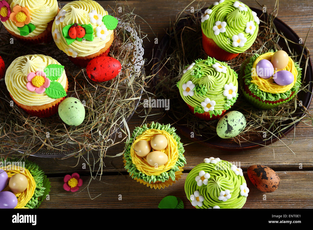 Easter cupcakes on hay, food closeup - Stock Image