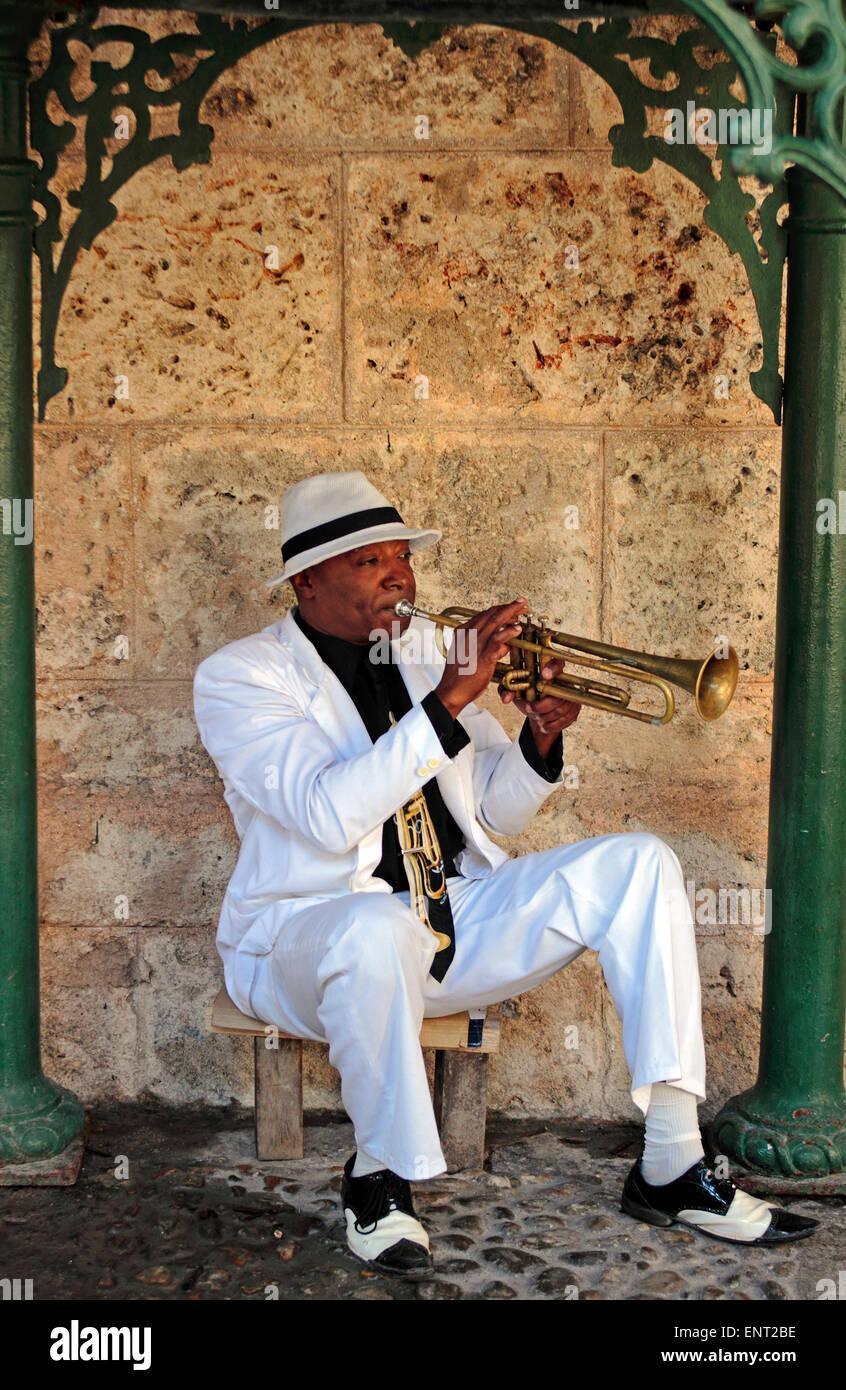 Cuban trumpet player performing in a small park, Havana, Cuba - Stock Image