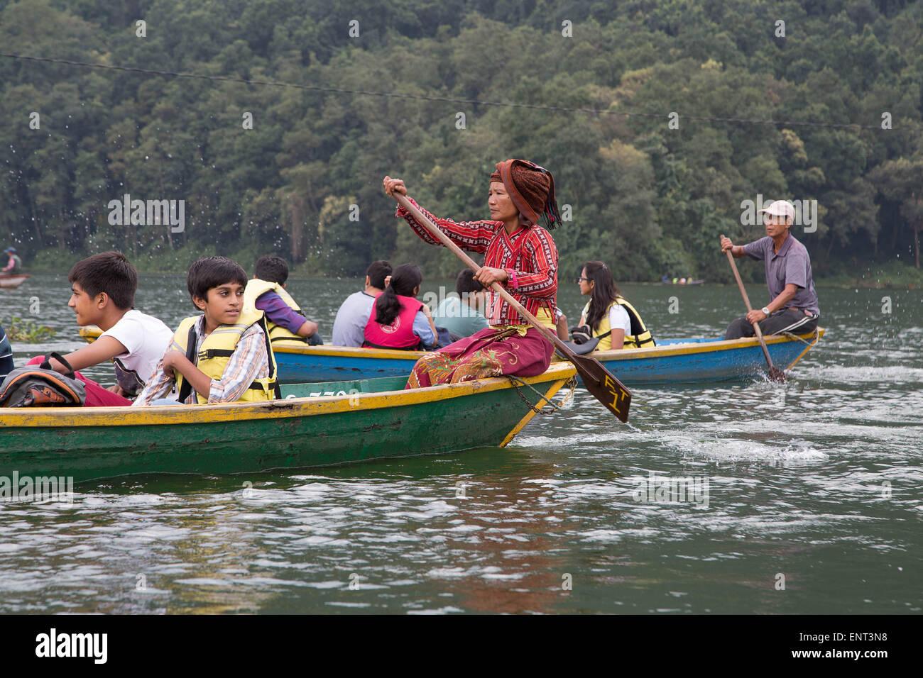 Rowing Across Pokhara Lake, Nepal - Stock Image