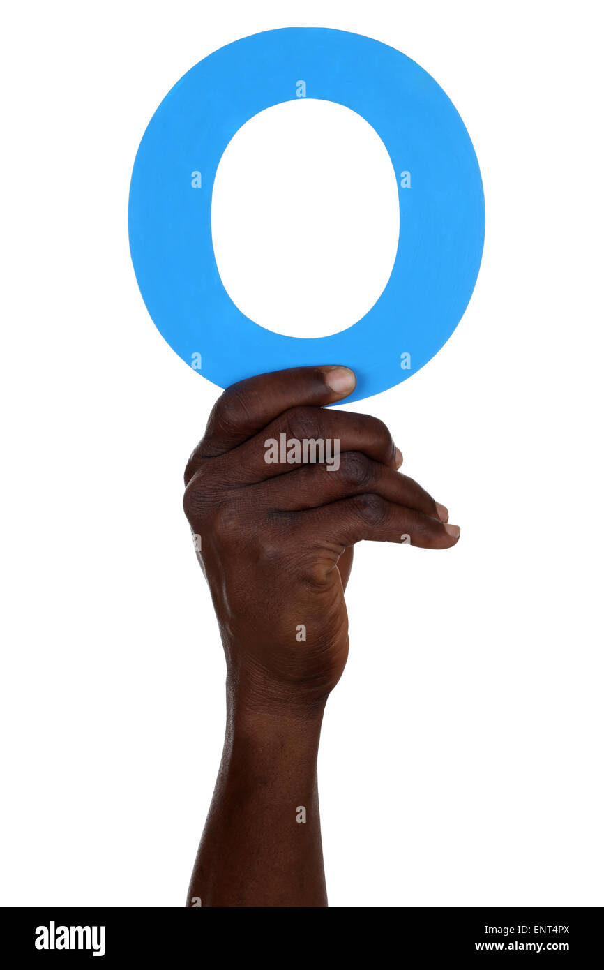 Hand holding letter O number 0 from alphabet isolated on a white background - Stock Image