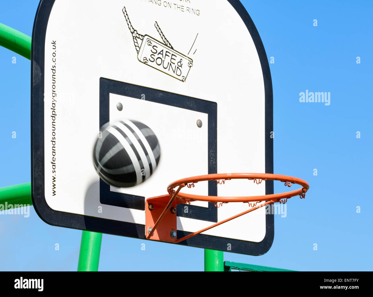 Basketball through at a hoop and missing. - Stock Image