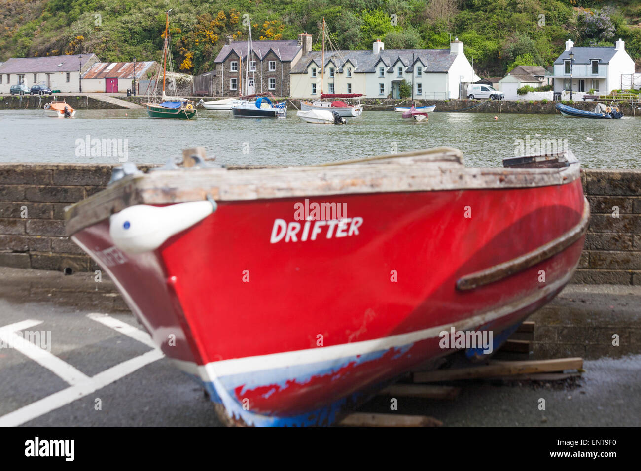 Drifter boat with cottages in the distance at Lower Fishguard or Abergwaun at Pembrokeshire Coast National Park, - Stock Image