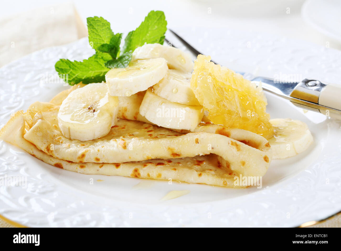 Pancakes on a white plate, food - Stock Image