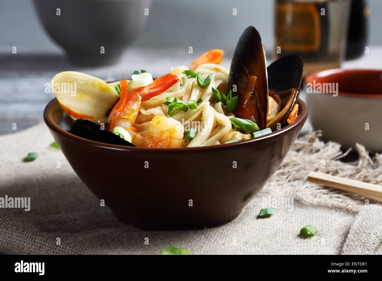 noodles with mussels and onions, food - Stock Image