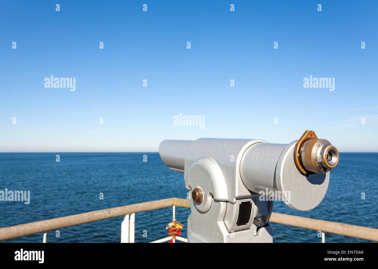 Telescope on a pier pointed at horizon, future concept. - Stock Image