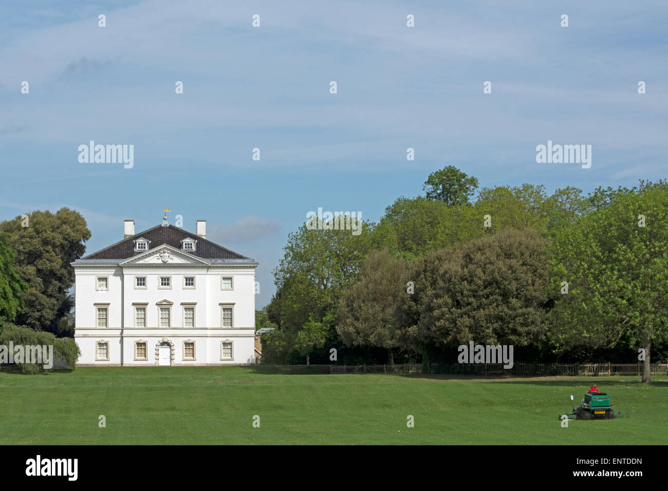 lawn being mowed in marble hill park, the grounds of marble hill house, twickenham, middlesex, england - Stock Image