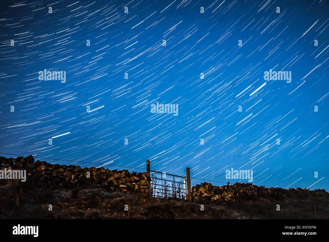 Star trail in the night sky - stars in starry sky in the dark, UK - Stock Image