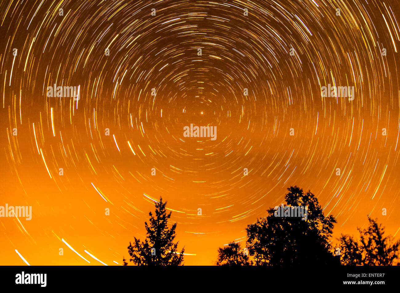 A star trail image showing the movement of the stars as the Earth moves around on its axis in the night sky, Scotland, - Stock Image