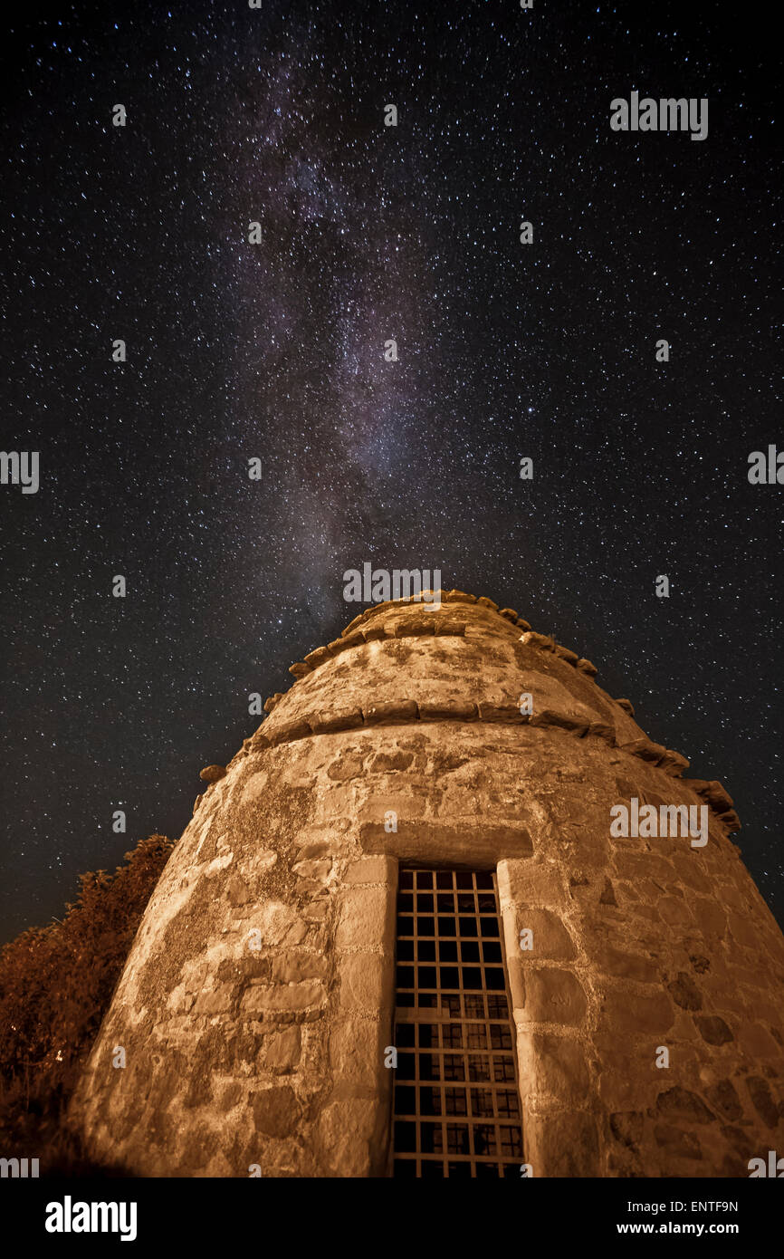 The Milky Way Galaxy towers over a dovecot in Dunure, Scotland, UK - Stock Image