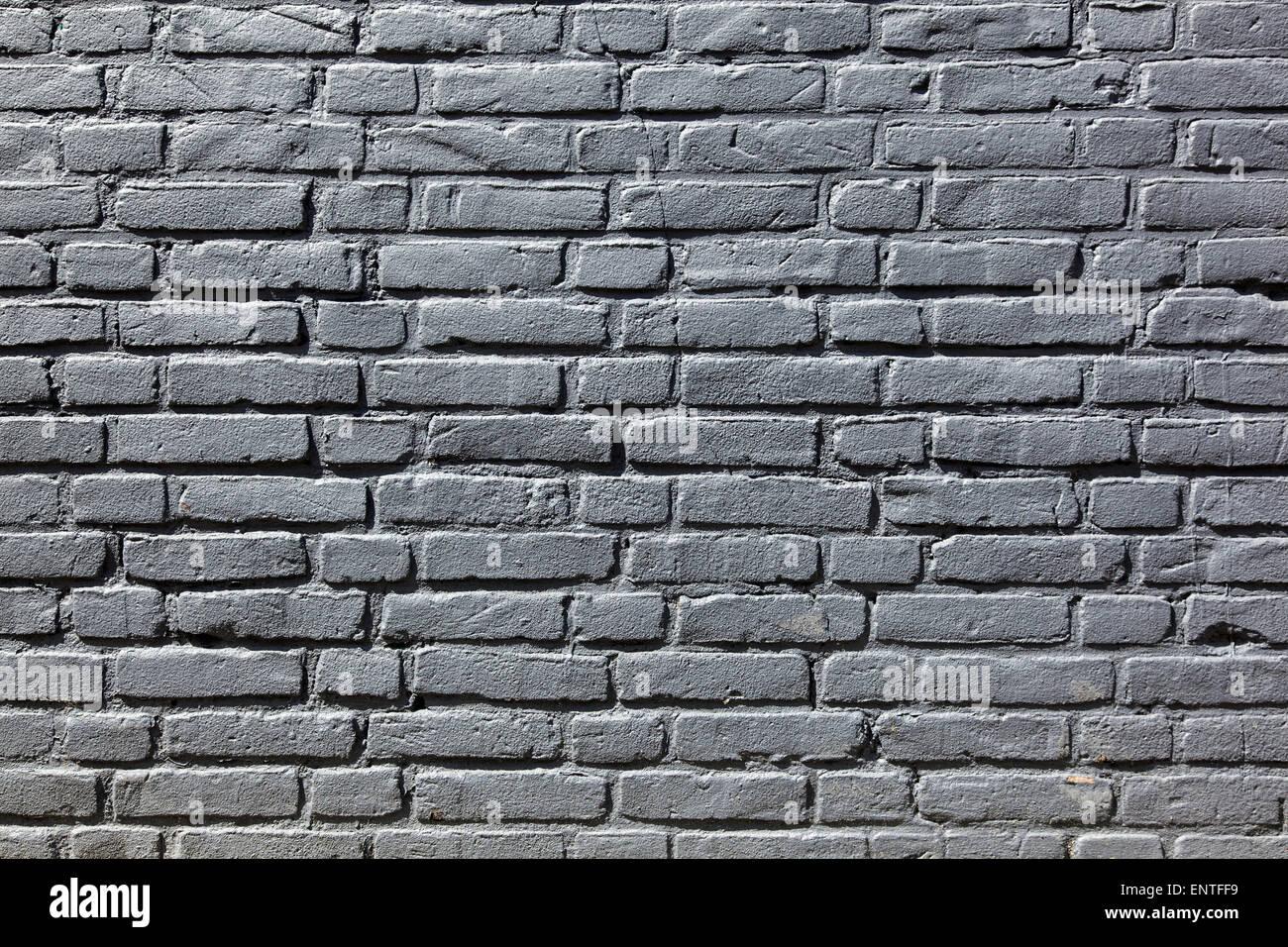 horozontal part of gray painted brick wall - Stock Image