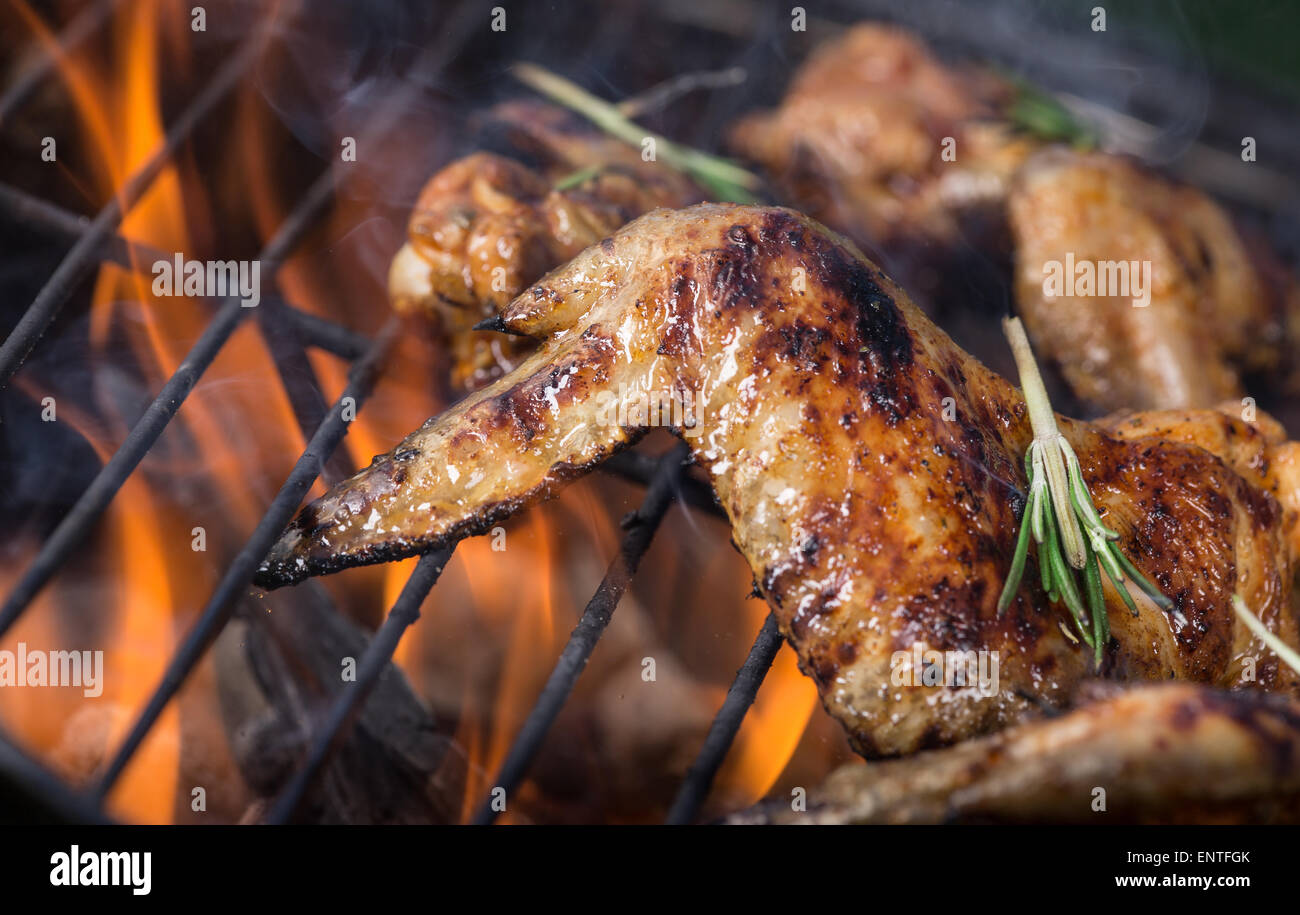 Delicious chicken wings on garden grill, close-up Stock Photo ...