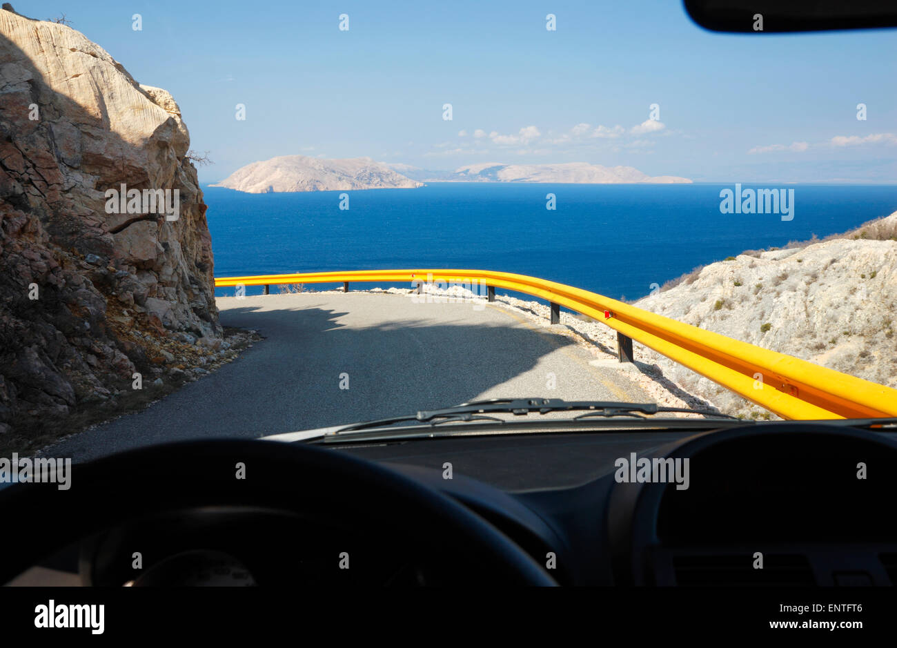 Steering wheel and dashboard of a car on road in Croatia - Stock Image