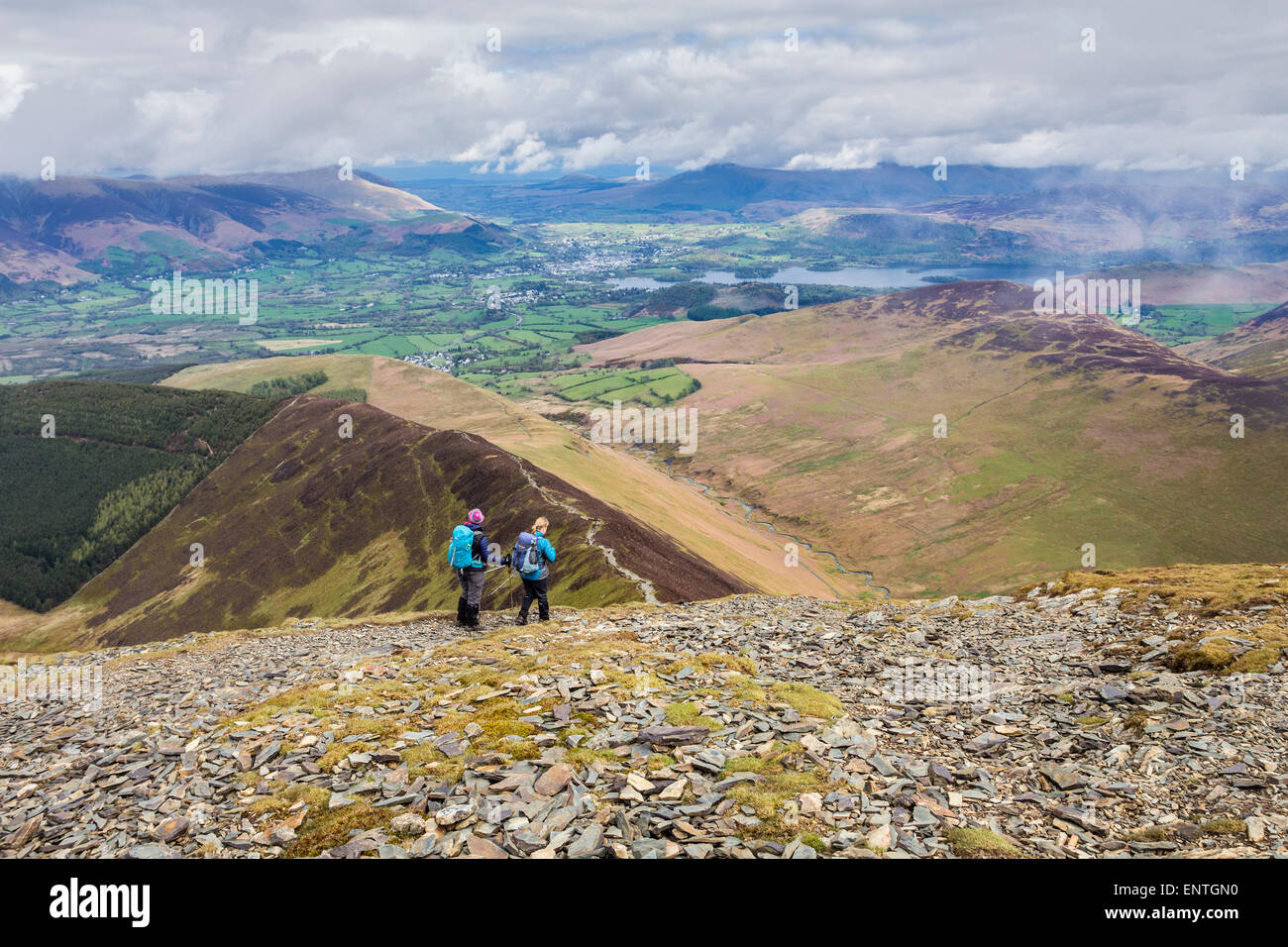 Walkers Decending Towards Sleet How From Grisedale Pike, Lake District, Cumbria UK - Stock Image