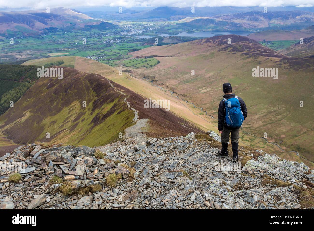 Walker Decending Towards Sleet How From Grisedale Pike, Lake District, Cumbria UK - Stock Image