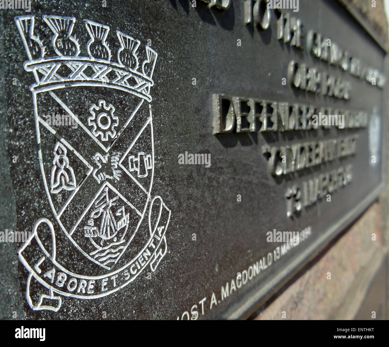 The old Clydebank coat of arms on the Memorial opposite Clydebank Town Hall - Stock Image