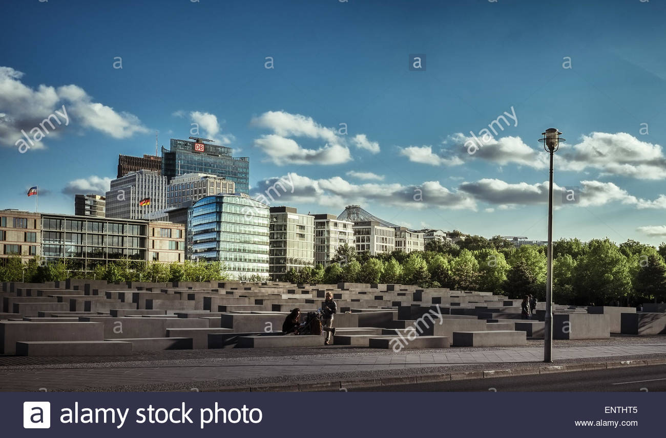 Memorial to the Murdered Jews with Potsdamer Platz in the background - Berlin, Germany - Stock Image