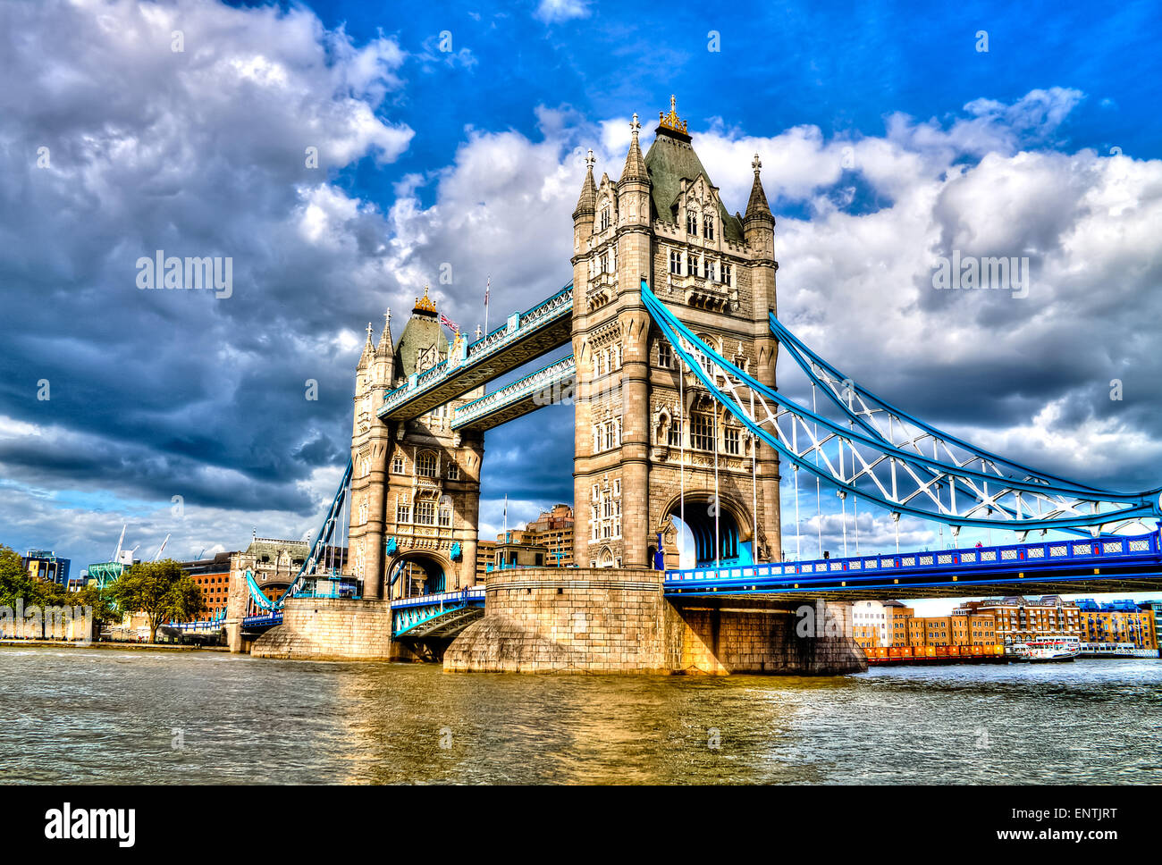 Tower Bridge, famous combined bascule and suspension bridge which crosses River Thames. London, United Kingdom. - Stock Image