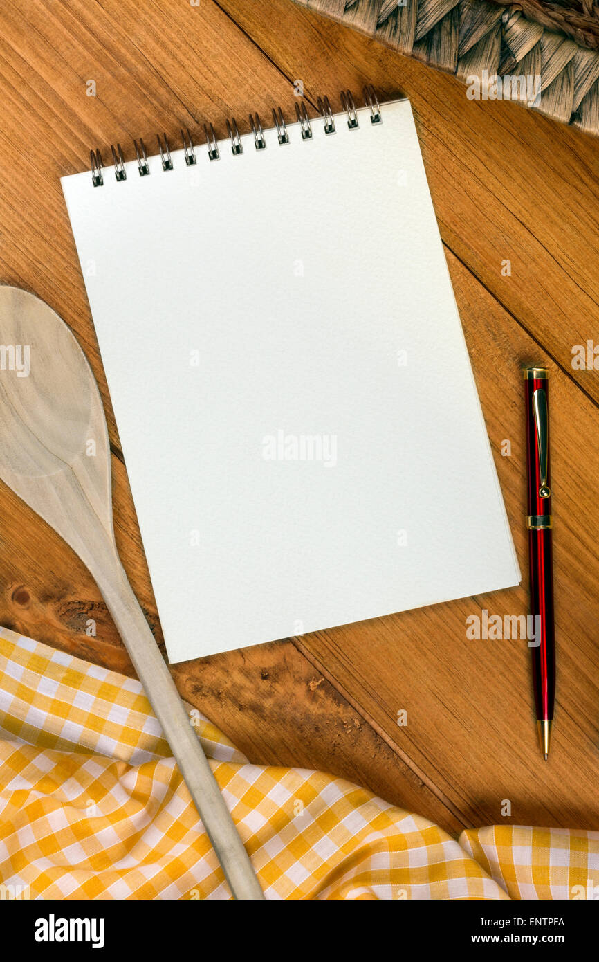 A Cooks Notepad on a farmhouse kitchen table - Space for Text - Stock Image