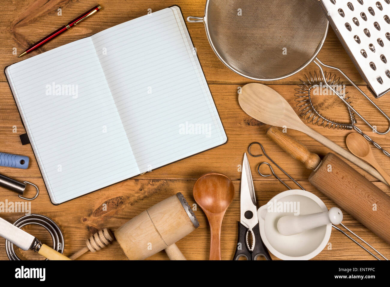 A selection of Kitchen Utensils on a farmhouse kitchen table - with Space for Text - Stock Image