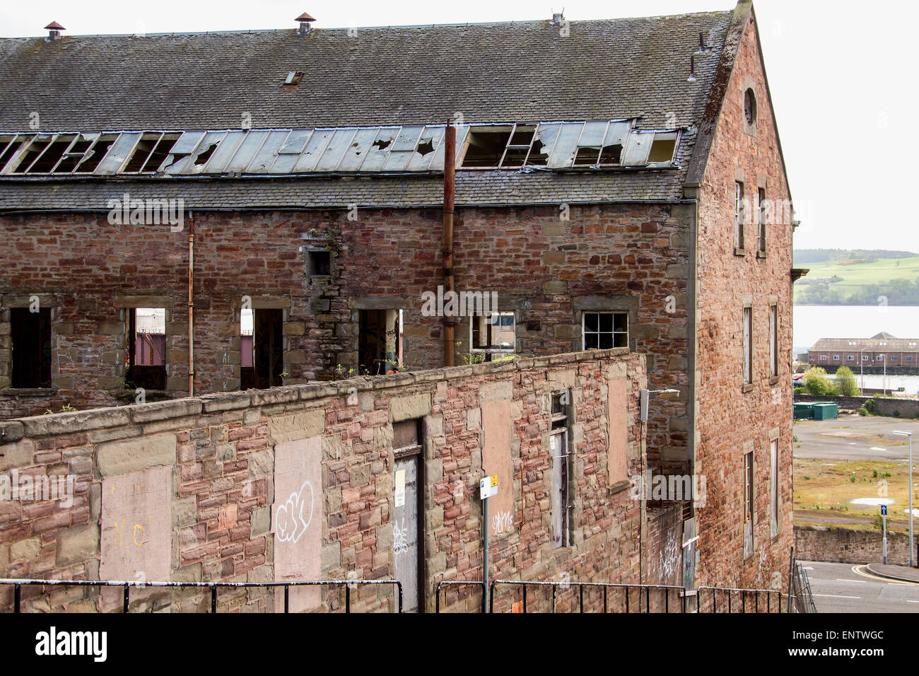 View at back of the 1836 derelict William Halley & Sons Ltd Jute Mill which is a Listed Building in Dundee,UK - Stock Image