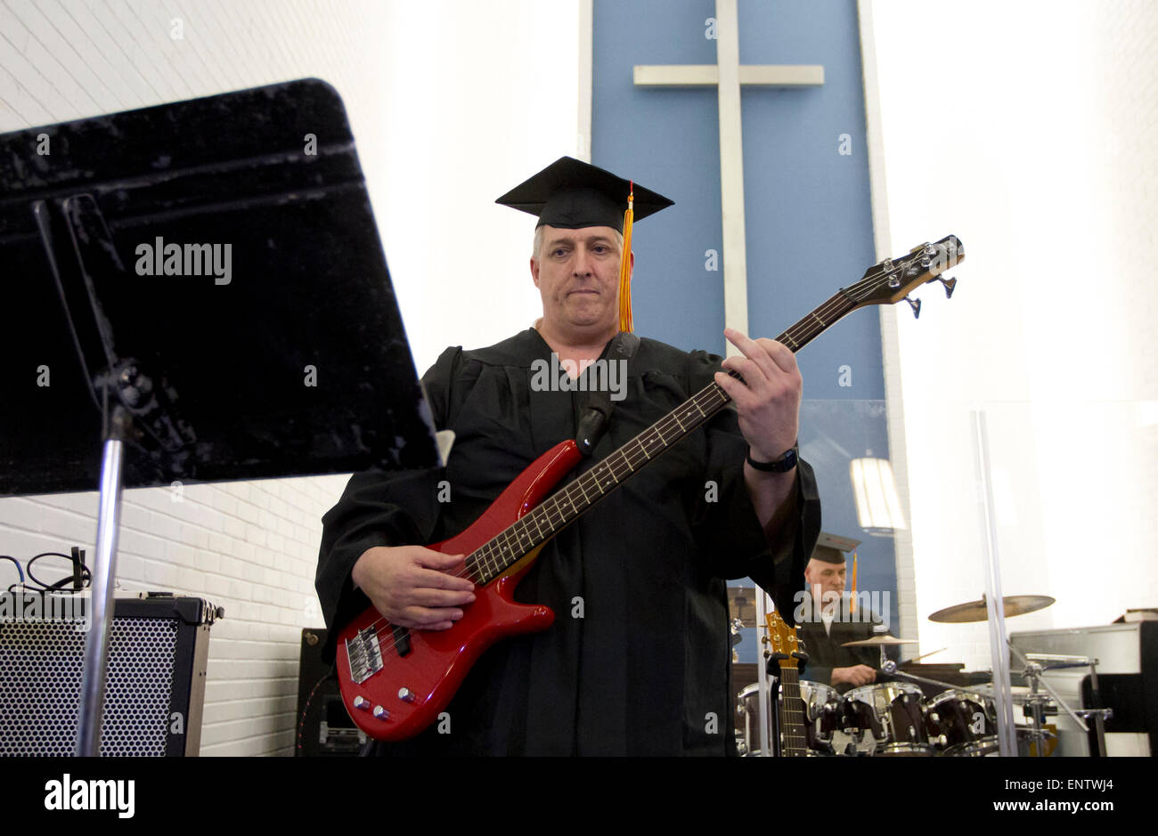 Male inmate graduate of a Christian ministry program inside a  maximum security prison near Houston, Texas plays - Stock Image